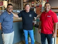 Todd Graves, founder of Raising Cane's Chicken Fingers (center), visited 10 restaurants on the Discovery+ TV show 'Restaurant Recovery.' One of the restaurants was Dallas' Smokey John's Bar-B-Que & Home Cooking, co-owned by brothers Brent Reaves (left) and Juan Reaves.