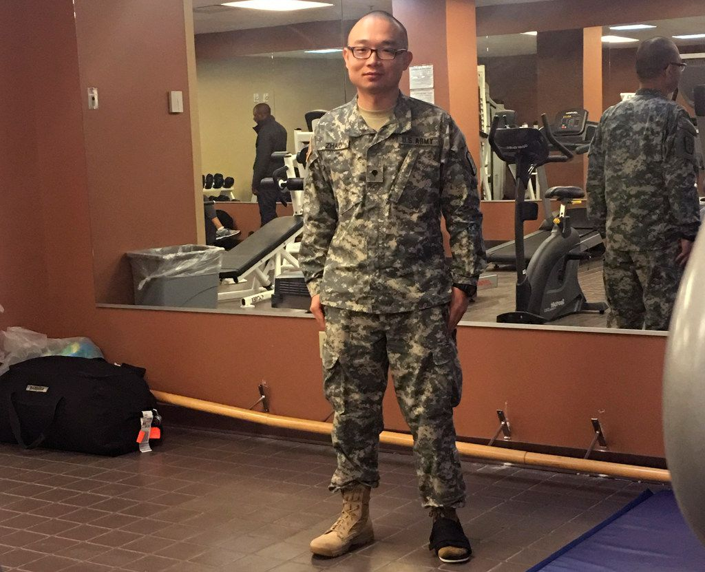 """This photo provided by Panshu Zhao shows Zhao in uniform on Feb. 11, at a U.S. Army Reserve installation in Houston.  Zhao is one of dozens, if not more, devastated immigrant military recruits and reservists struggling this summer with abrupt and often inexplicable discharges and canceled contracts. They enlisted with a promised path to citizenship in exchange for being willing to risk their lives for the U.S., a timeworn exchange that's added linguists, medical specialists and others to the military since the Revolutionary War.  """"It's just like you're dropped from heaven to hell,"""" Zhao told The Associated Press on July 6."""