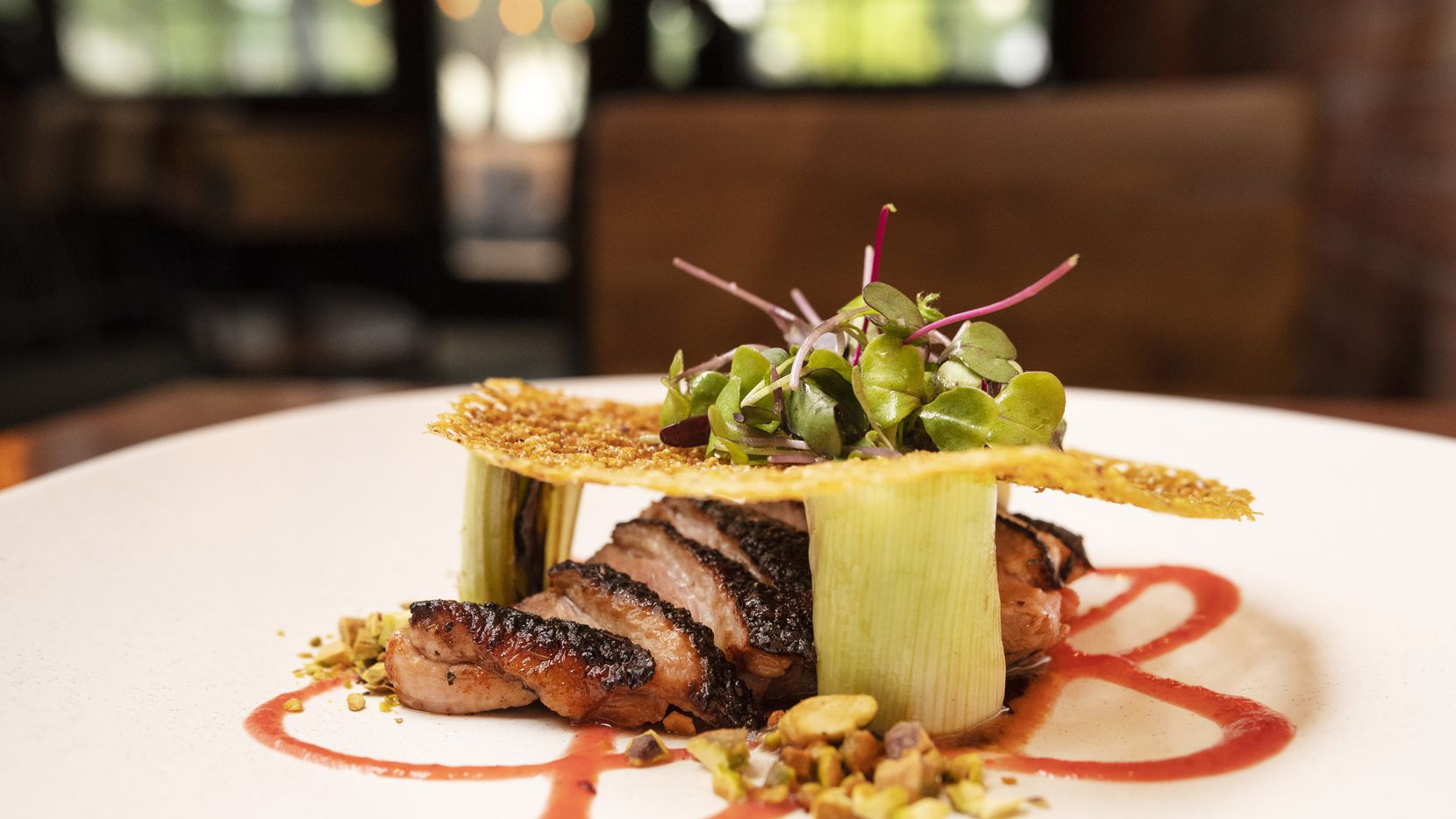 Rye in Dallas reminds us how fun food can be. Here's Release the Quack-en: citrus brined duck, charred leeks, strawberry boshi, pomegranate vinaigrette and pistachio.