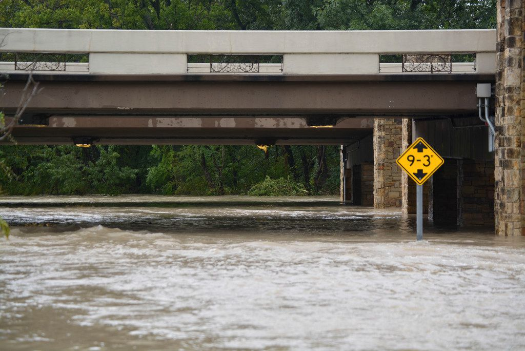 Water flooding out of the banks of White Rock Creek underneath E. NW Highway in Dallas.