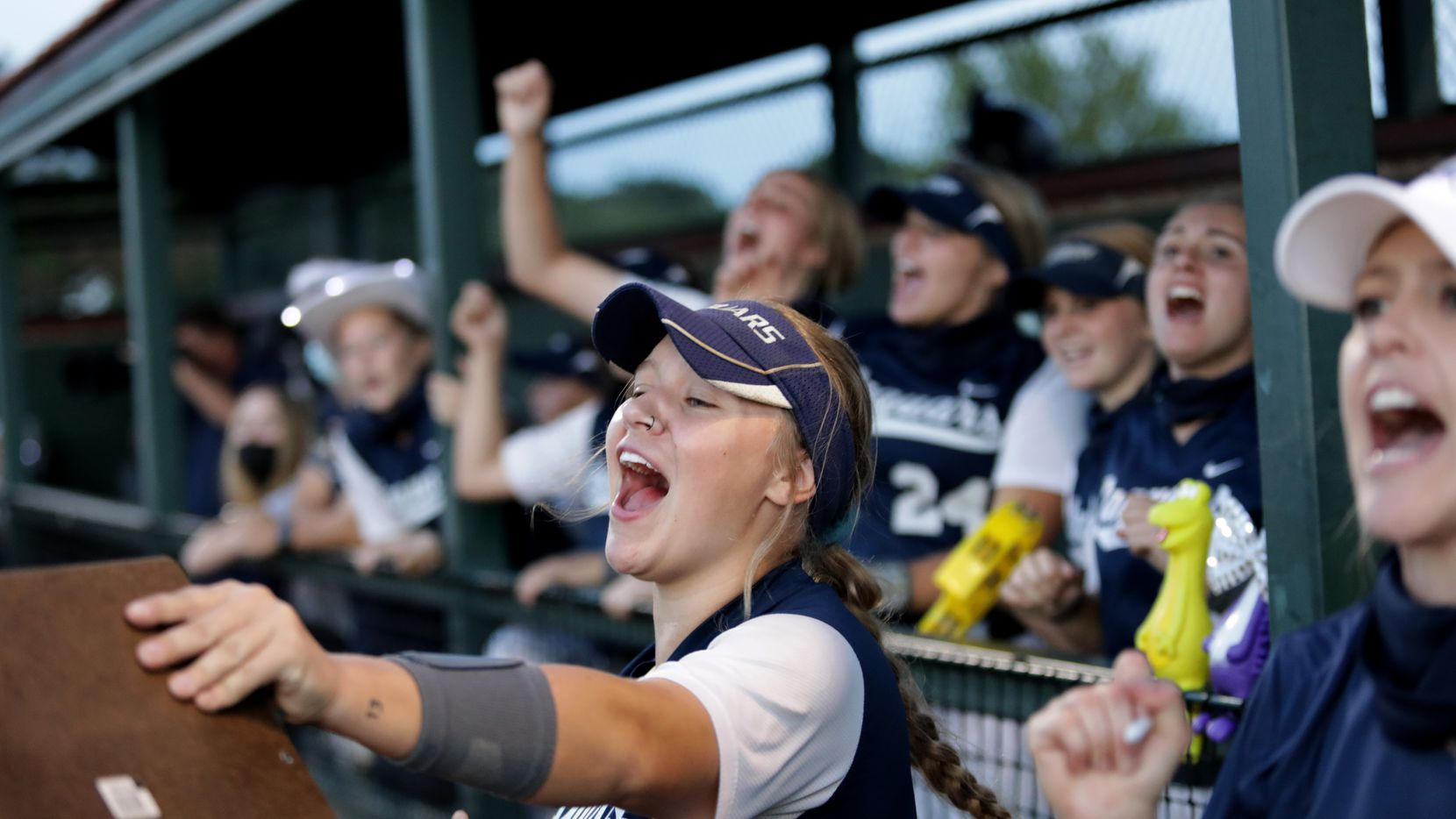 Flower Mound players cheer on their team during a 10-0 victory over Allen on Friday night in Game 2 of a best-of-3 Class 6A Region I quarterfinal series. (Jason Janik/Special Contributor)