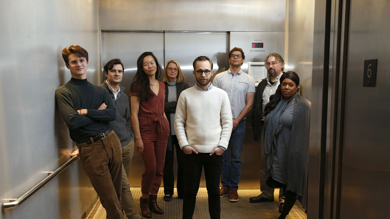 """Jeremy LeBlanc, Cory Kosel, Sydney Lo, Cindee Mayfield, Jake Nice, Jon Garrard, Brian Witkowicz, and Detra Payne  from the play """"Slide By,"""" pose for a portrait in the elevator on the sixth floor of the Studio Theatre at Wyly Theatre in Dallas on Tuesday, January 7, 2020."""