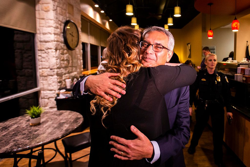 Tarrant County Republican Party  vice chair Dr. Shahid Shafi hugs a supporter after the county party voted down an effort to remove him based on his religion and unfounded claims that he favored Sharia over American law. (Smiley N. Pool/The Dallas Morning News)