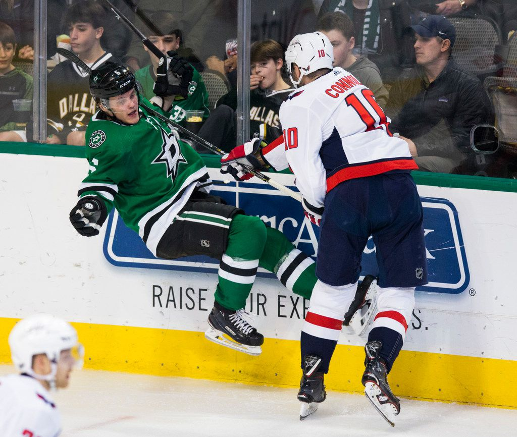 Dallas Stars defenseman Julius Honka (6) gets hit in the shoulder with Washington Capitals right wing Brett Connolly's (10) stick during the second period of an NHL game between the Dallas Stars and the Washington Capitals on Friday, January 4, 2019 at the American Airlines Center in Dallas.