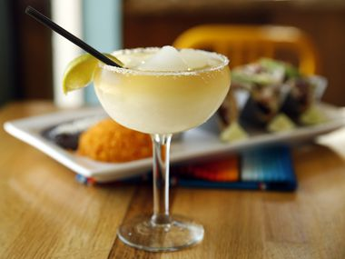 The frozen house margarita is served with fish tacos at El Rincon Mexican Restaurant & Tequila Bar in downtown Carrollton, Texas, Thursday, April 25, 2019.