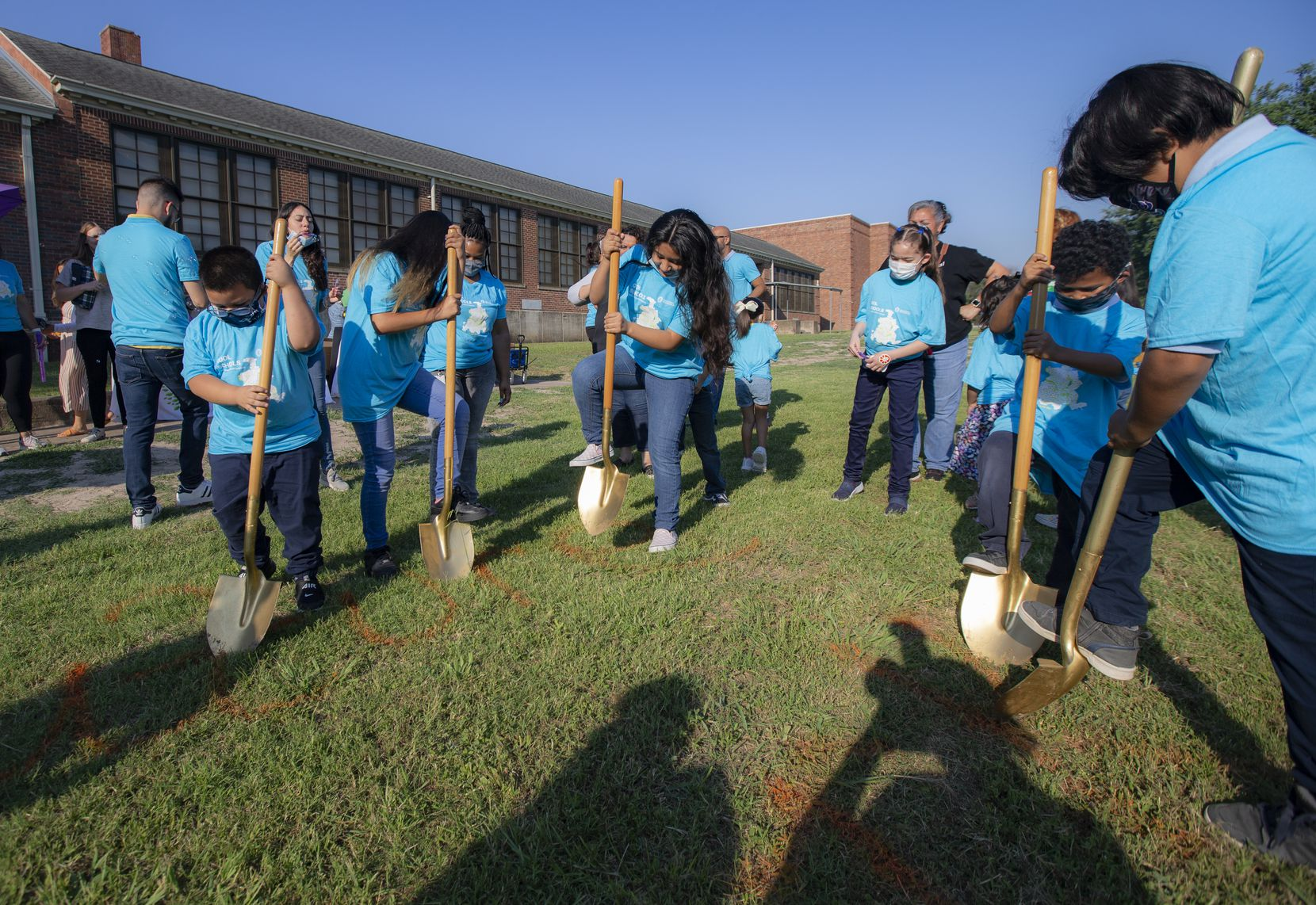 Leila P. Cowart Elementary School students participate in a Texas Trees Foundation ground breaking ceremony at their school, Friday, June 18, 2021. The school will host a Cool School Neighborhood Park on its grounds for the community.