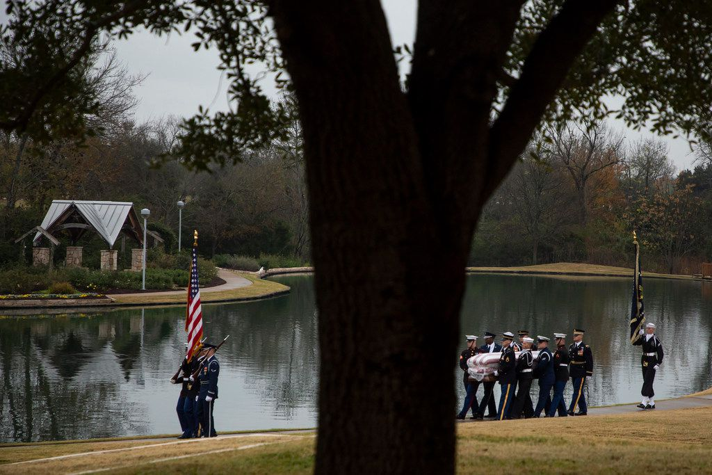 The flag-draped casket of President George H.W. Bush is carried to a burial plot close to his presidential library for internment on Thursday, Dec. 6, 2018, in College Station, Texas. (Smiley N. Pool/The Dallas Morning News)