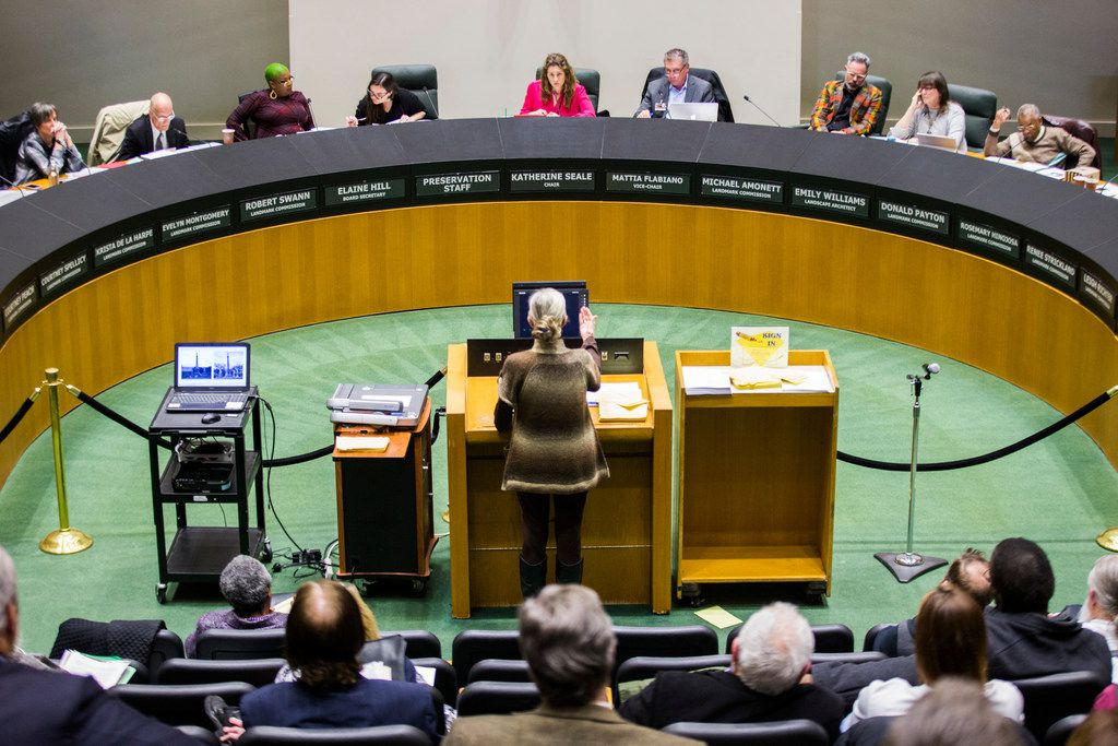Allison Reaves speaks in the public hearing forum at the Dallas Landmark Commission, before they voted to remove the Confederate War Memorial that currently stands in front of the downtown convention center on Monday, March 4, 2019 at Dallas City Hall. Images of the memorial are displayed behind Carter. Reaves was the chair of the commission when the monument became designated. (Ashley Landis/The Dallas Morning News)