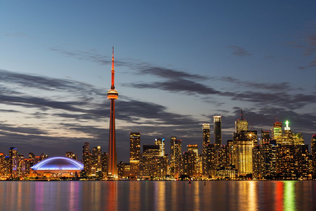 The skyline of Toronto at night. Downloaded from iStockphoto on Oct. 20, 2017. The illuminated Toronto skyline with Lake Ontario in the foreground, as seen from Center Island.