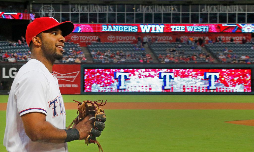 Texas Rangers shortstop Elvis Andrus (1) warms up before the game as the scoreboard proclaims the Rangers 2016 western division title before the Milwaukee Brewers vs. the Texas Rangers major league baseball game at Globe Life Park in Arlington on Monday, September 26, 2016. (Louis DeLuca/The Dallas Morning News)