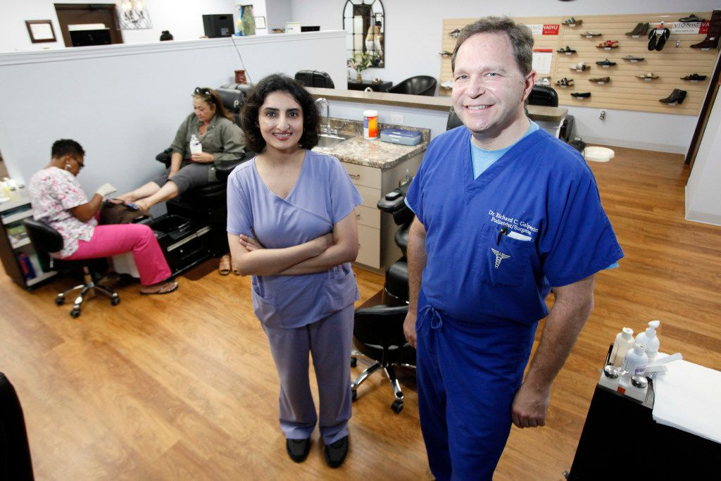 Maryam Raza, medical director for the wound care and hyperbaric medicine at Methodist Medical Center,  with Richard Galperin, doctor of podiatric medicine, at Nail MD in Dallas. (Ben Torres/Special Contributor)
