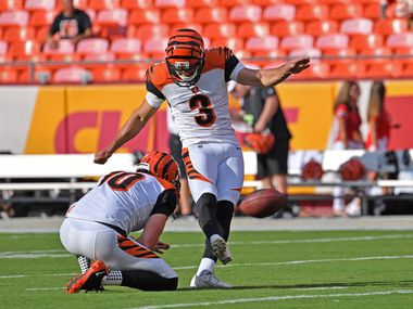KANSAS CITY, MO - AUGUST 10: Tristan Vizcaino #3 of the Cincinnati Bengals kicks field goals during pregame warm ups before a preseason game against the Kansas City Chiefs at Arrowhead Stadium on August 10, 2019 in Kansas City, Missouri. (Photo by Peter Aiken/Getty Images)