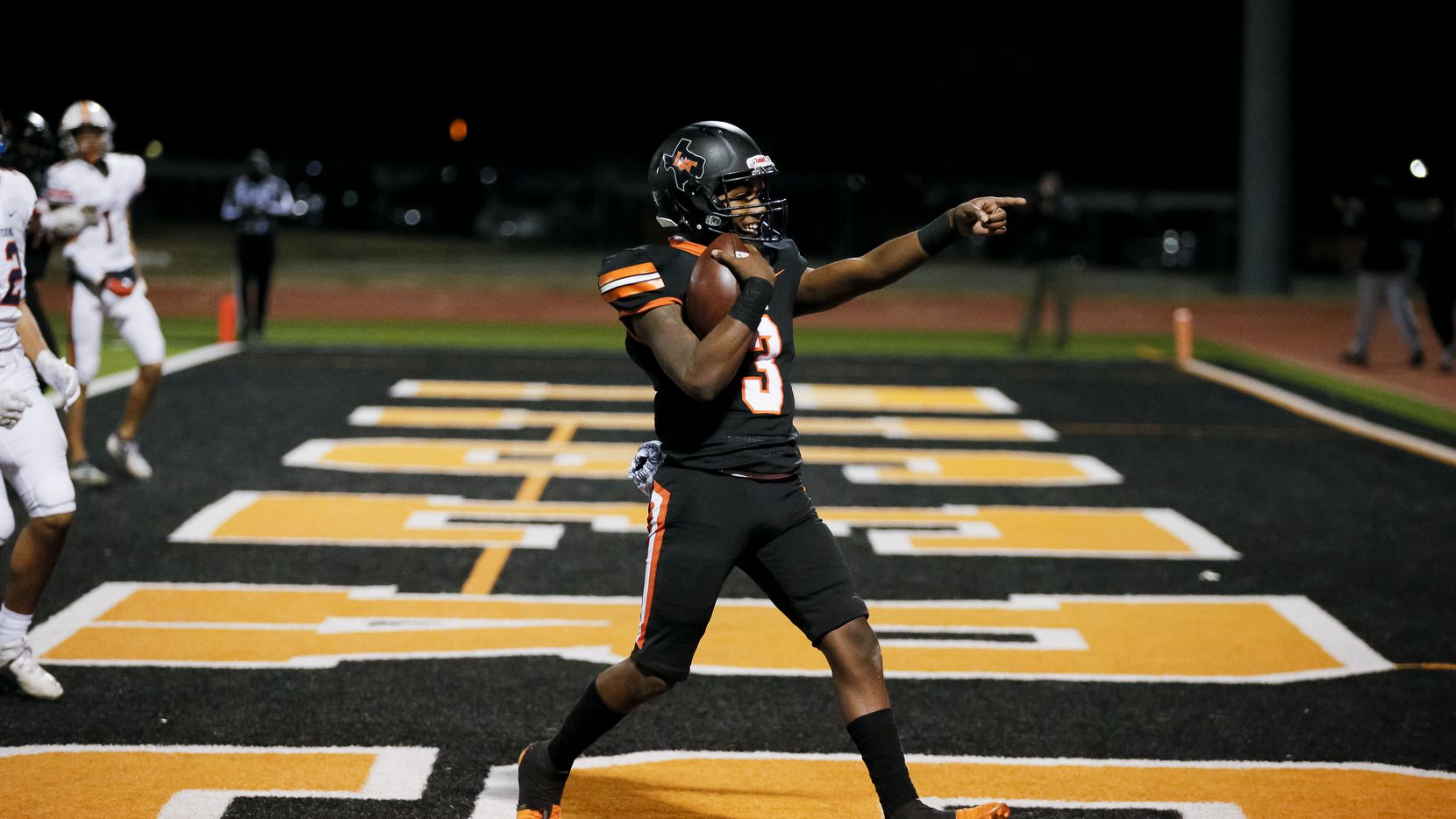 Lancaster junior quarterback Glenn Rice Jr. (3) celebrates scoring a touchdown during the first half of a class 5A Division I bi-district round playoff game against Wakeland at Tiger Stadium in Lancaster, Friday, December 11, 2020. Lancaster won 29-6.
