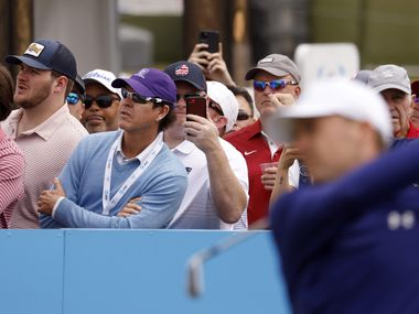 Some fans watch the path of Jordan Spieth's ball as others Fans record Spieth on the 7th tee during round 2 of the AT&T Byron Nelson  at TPC Craig Ranch on Friday, May 14, 2021in McKinney, Texas. (Vernon Bryant/The Dallas Morning News)
