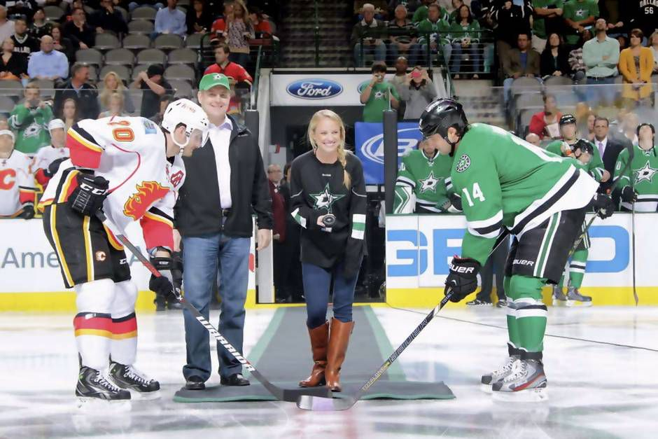 Julie Dobbs  (center) travels with the Dallas Stars as part of her busy schedule with the team