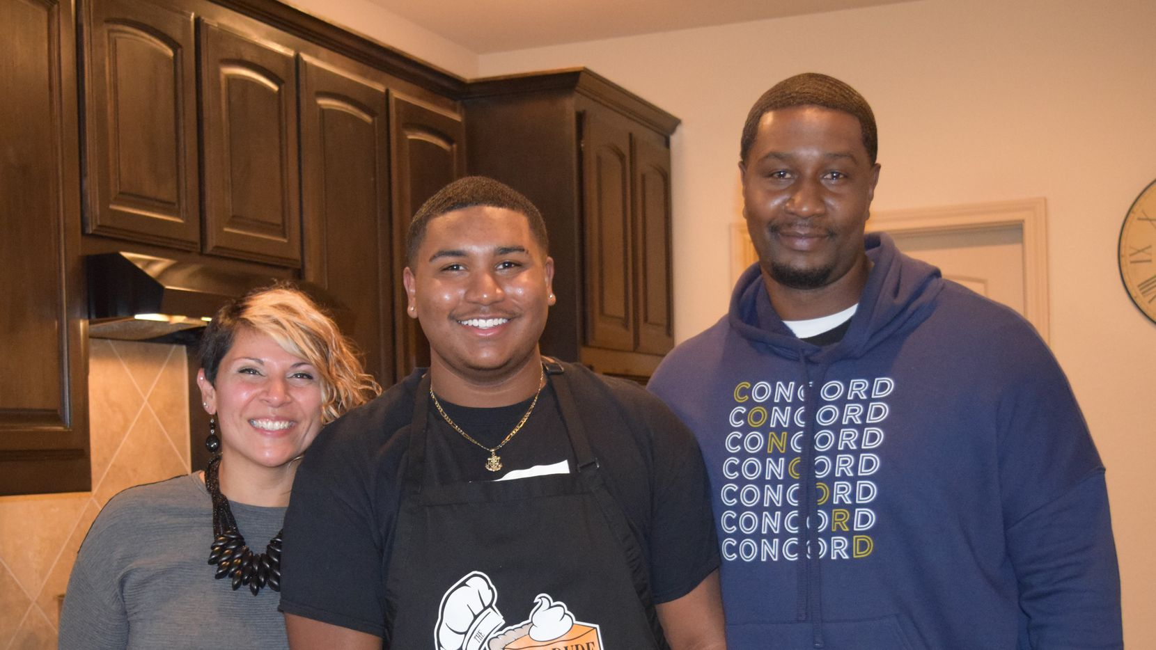 "DeSoto's ""The Pie Dude"" (center, Kevin Robinson Jr.) with his mother Jackie and father Kevin Robinson Sr."