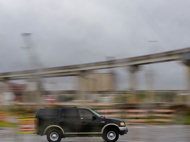 A truck drives past a bridge under construction near Texas State Highway 360 and Interstate 30 in Arlington, 2018. Interstate 30 will close in both directions this weekend for work on the interchange at State Highway 360.