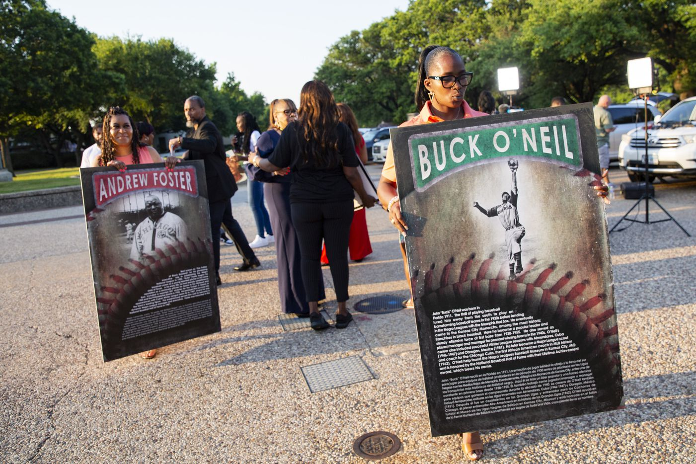 Sherry Blair (right) holds a Buck O'Neil sign thats part of the Negro League Baseball exhibit on Friday, June 18, 2021, during a media preview at Fair Park in Dallas. The exhibit opens Saturday as part of the Juneteenth Celebration in Fair Park. (Juan Figueroa/The Dallas Morning News)