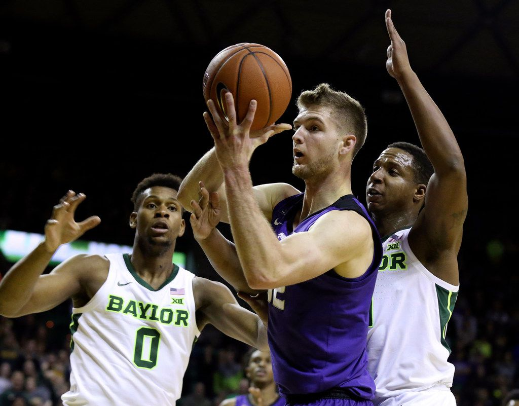 Kansas State forward Dean Wade, center, is guarded by Baylor guard Mark Vital, right, and forward Flo Thamba, left, in the first half of an NCAA college basketball game, Saturday, Feb. 9, 2019, in Waco, Texas. (Rod Aydelotte/Waco Tribune Herald, via AP)