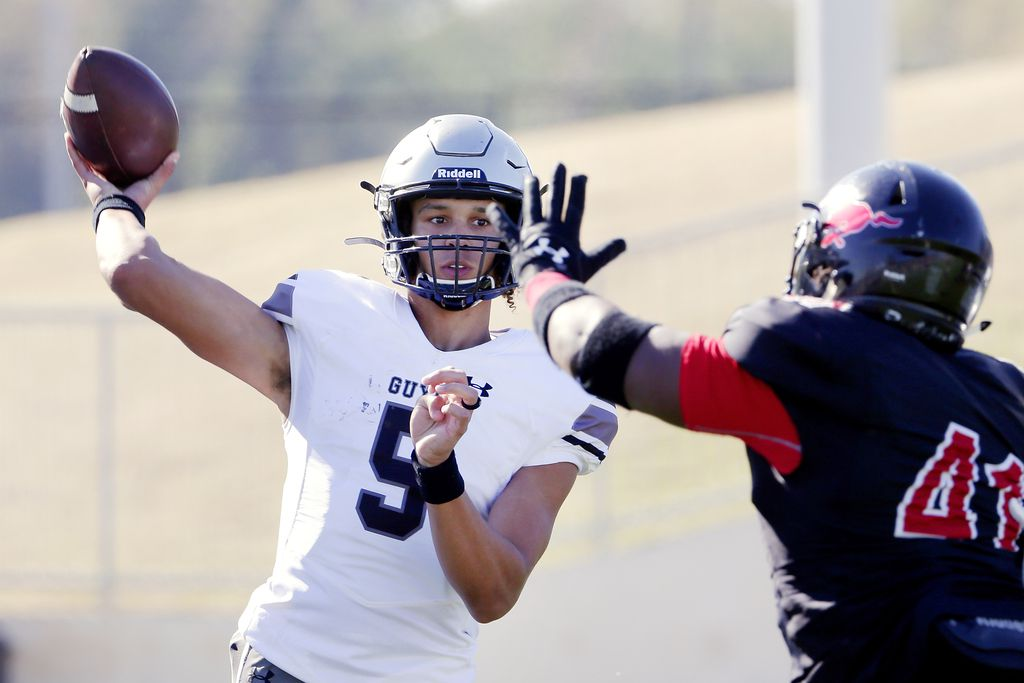 Guyer quarterback Eli Stower (5) passes the ball as Spring Westfield defensive lineman Johnnie Scott (41) closes in during the first half of their 6A Div. 2 state semi-final game Saturday, Dec. 14, 2019 at the Sheldon ISD Panther Stadium in Houston, TX.