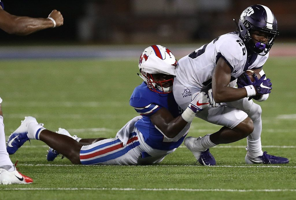 DALLAS, TX - SEPTEMBER 07:  KaVontae Turpin #25 of the TCU Horned Frogs is tackled by Christian Davis #28 of the Southern Methodist Mustangs at Gerald J. Ford Stadium on September 7, 2018 in Dallas, Texas.  (Photo by Ronald Martinez/Getty Images)