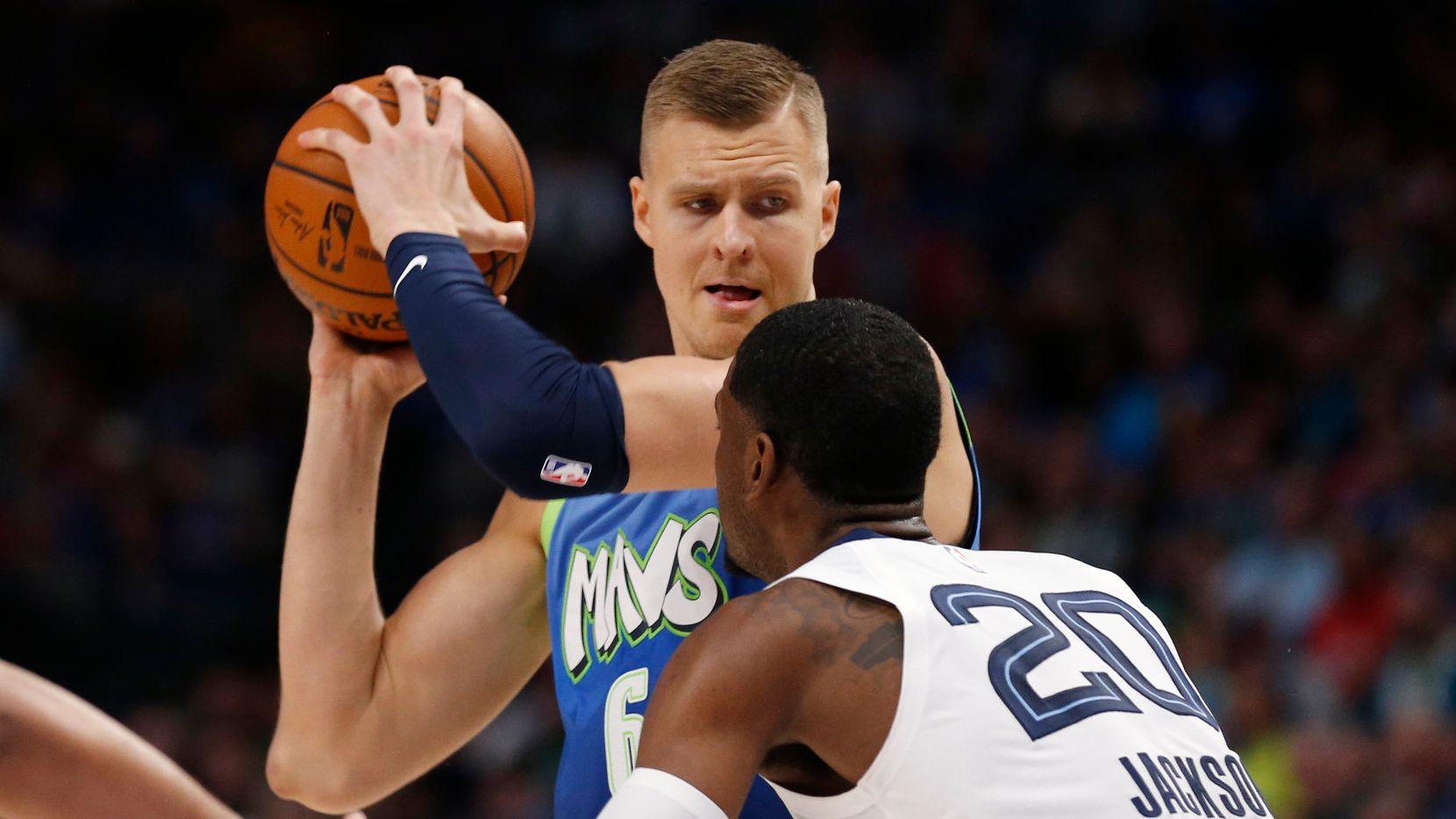 Dallas Mavericks forward Kristaps Porzingis (6) looks back as Memphis Grizzlies guard Josh Jackson (20) defends during the second half of play at American Airlines Center in Dallas on Friday, March 6, 2020. Dallas Mavericks defeated the Memphis Grizzlies 121-96.