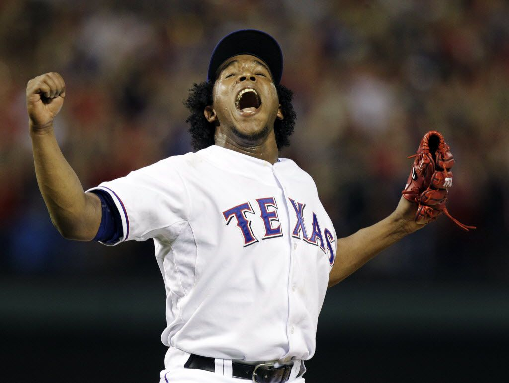 ORG XMIT: NY155 FILE-This Oct. 22, 2010 file photo shows Texas Rangers relief pitcher Neftali Feliz celebrating after striking out New York Yankees' Alex Rodriguez for the final out in the Rangers' 6-1 win in Game 6 of baseball's American League Championship Series  in Arlington, Texas.  Feliz was named American League Rookie of the Year by the  Baseball Writers' Association of America Monday Nov. 15, 2010. (AP Photo/Chris O'Meara,File) 11172010xALDIA 12252010xALDIA