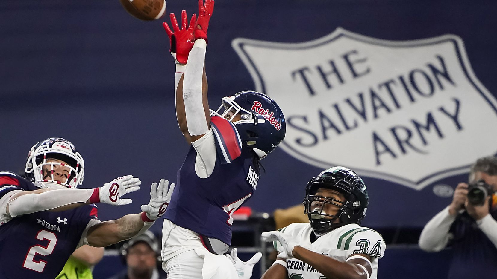 Denton Ryan defensive back Ty Marsh (4) intercepts a pass intended for Cedar Park wide receiver Josh Cameron (34) during the first half of the Class 5A Division I state football championship game at AT&T Stadium on Friday, Jan. 15, 2021, in Arlington, Texas. (Smiley N. Pool/The Dallas Morning News)
