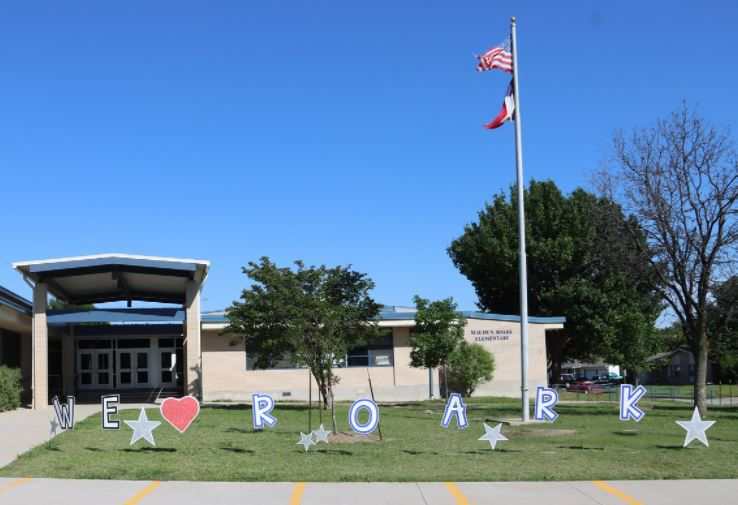 Decorations grace the lawn of Roark Elementary School in East Arlington on the last day of school at the building that will be demolished after this school year.