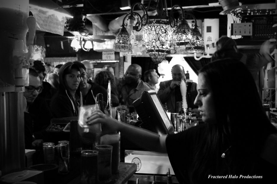 Customers sidle up to the Grapevine's front bar.