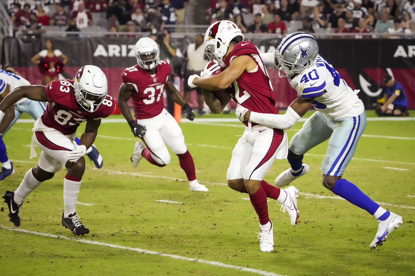 Dallas Cowboys cornerback Nahshon Wright (40) brings down Arizona Cardinals returner Andre Baccellia (82) in kick coverage during the second half of a preseason NFL football game at State Farm Stadium on Friday, Aug. 13, 2021, in Glendale, Ariz.