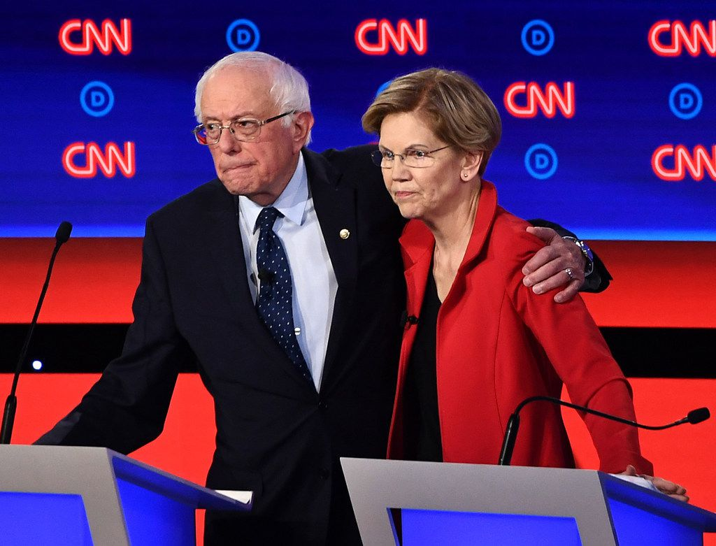 In this photo on July 30, 2019, Democratic presidential hopefuls Sen. Bernie Sanders and Sen. Elizabeth Warren after participating in the first round of the second Democratic primary debate of the 2020 presidential campaign season in Detroit.