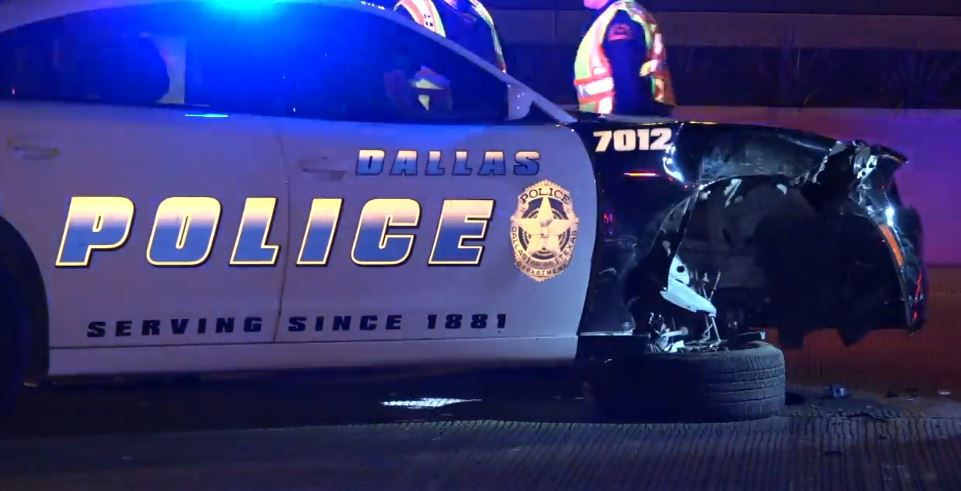 A Dallas police squad car was damaged when a passing Fiat 500 slammed into its front passenger side Wednesday morning. No one was injured, but a woman was taken into custody.