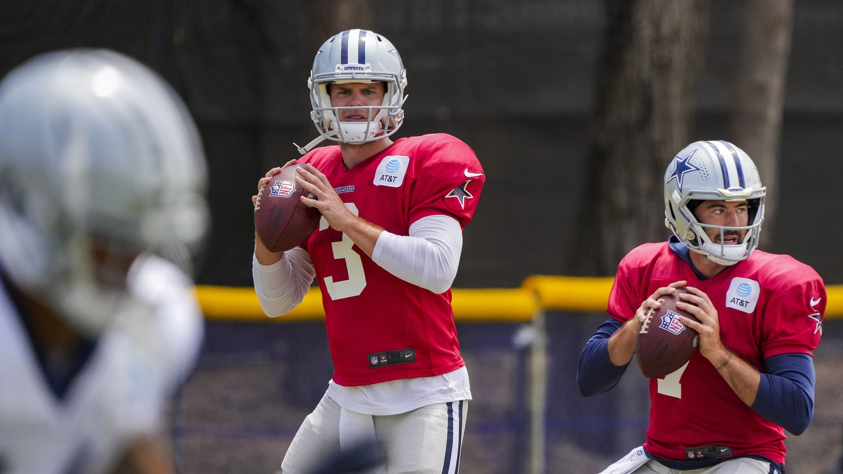 Dallas Cowboys quarterbacks Garrett Gilbert (3) and Ben DiNucci (7) prepare to throw passes during a practice at training camp on Saturday, July 31, 2021, in Oxnard, Calif.