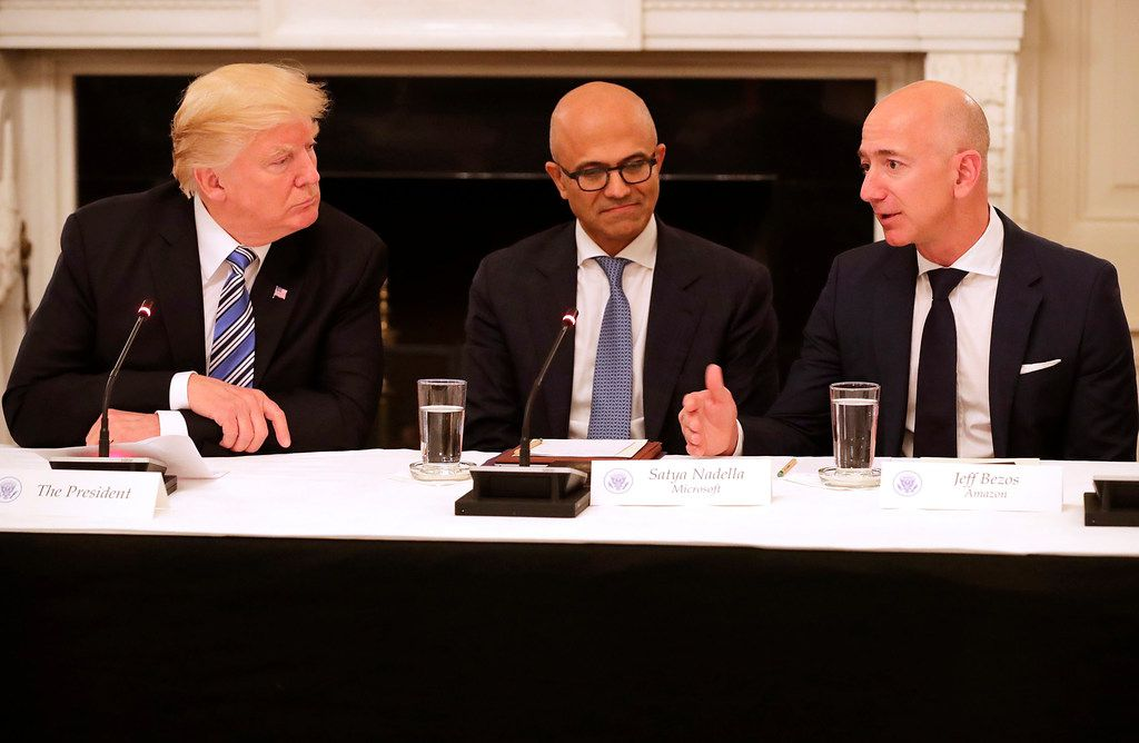 From left: President Donald Trump, Microsoft CEO Stya Nadella and Amazon CEO Jeff Bezos attended a meeting of the American Technology Council in the State Dining Room of the White House on June 19, 2017, in Washington, D.C.