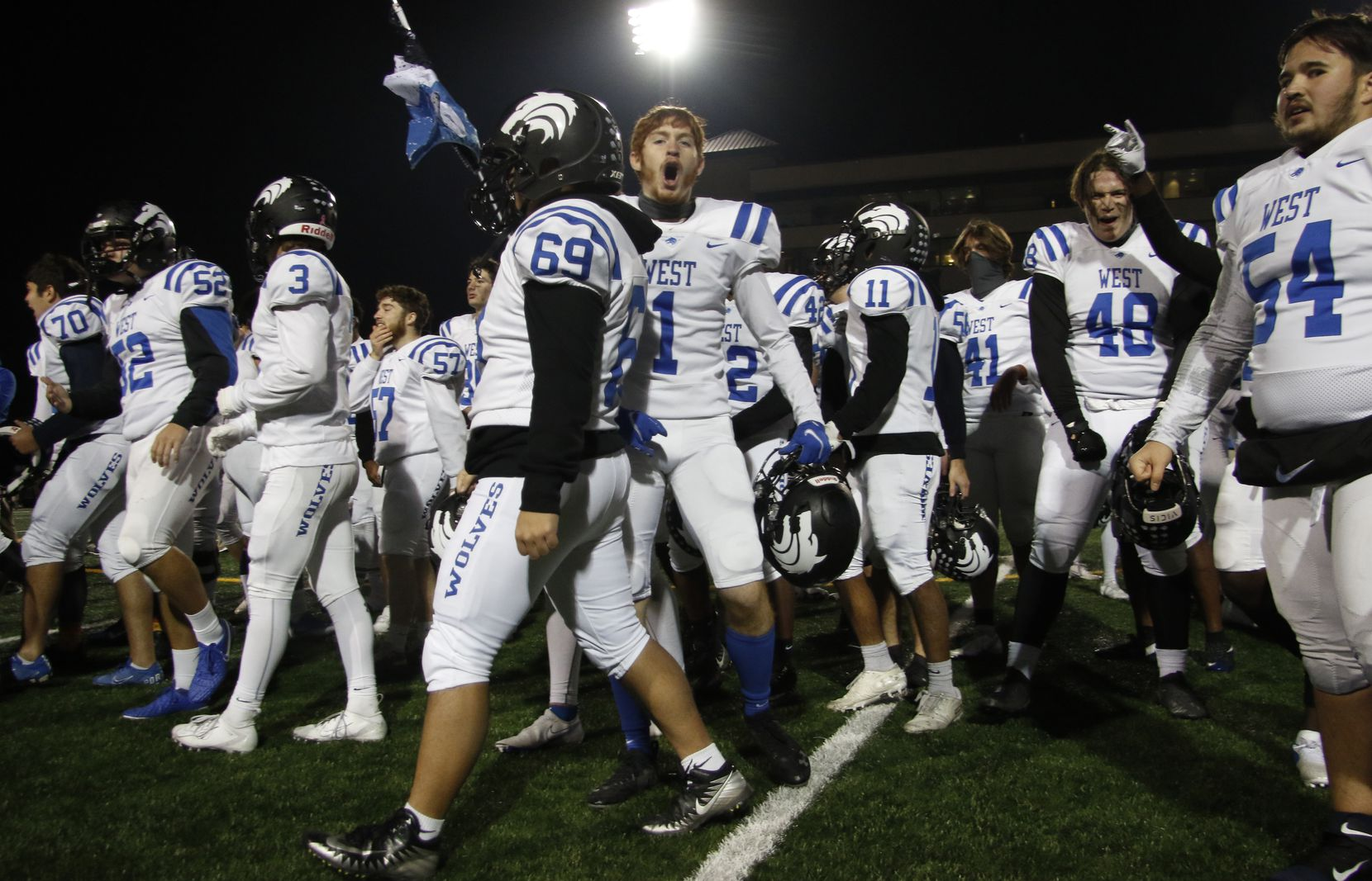 Plano West receiver Brayden Ardis (1) lets out a celebratory yell after the Plano West band finished playing their school song following their 31-24 come-from-behind victory over Plano to earn a playoff berth. The two teams played their District 6-6A football game at Clark Stadium in Plano on December 4, 2020. (Steve Hamm/ Special Contributor)