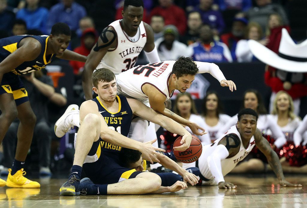 Texas Tech's Davide Moretti (25) and West Virginia's Logan Routt battle for a loose ball during the quarterfinals of the Big 12 Tournament at Sprint Center in Kansas City, Mo., on Thursday, March 14, 2019. West Virginia advanced, 79-74. **FOR USE WITH THIS STORY ONLY** (Jamie Squire/Getty Images/TNS)