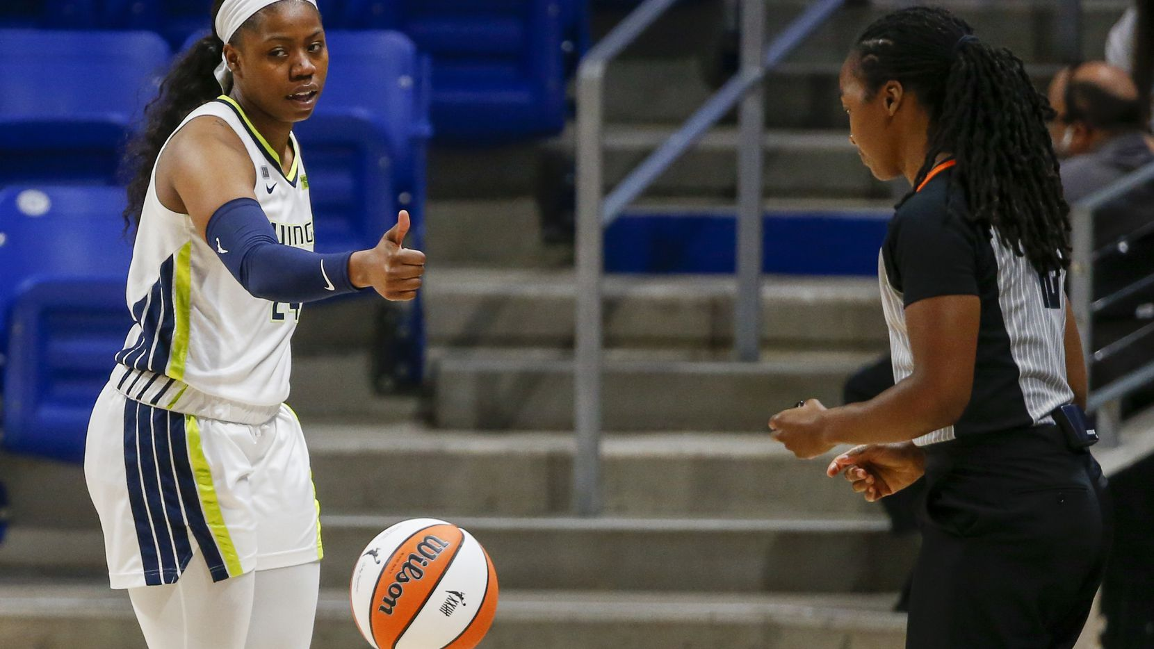 Dallas Wings guard Arike Ogunbowale (24) motions to the referee after a called foul during the first quarter against the Washington Mystics at College Park Center on Saturday, June 26, 2021, in Arlington. (Elias Valverde II/The Dallas Morning News)