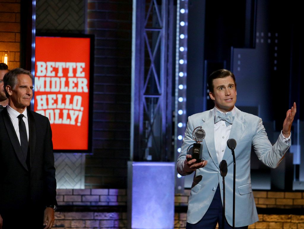 """Gavin Creel, right, accepts the award for best performance by an actor in a featured role in a musical for """"Hello, Dolly!"""" at the 71st annual Tony Awards on Sunday, June 11, 2017, in New York. (Photo by Michael Zorn/Invision/AP)"""