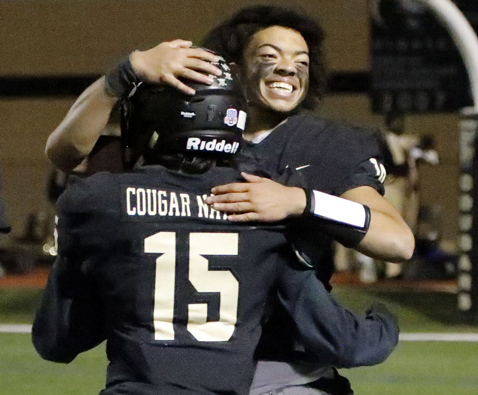 The Colony High School quarterback Jonathan Roberson (19) embraces The Colony High School outside linebacker Joshua Cano (15) after the win as The Colony High School hosted Frisco Reedy High School at Tommy Briggs Stadium on Friday night, December 4, 2020.  (Stewart F. House/Special Contributor)