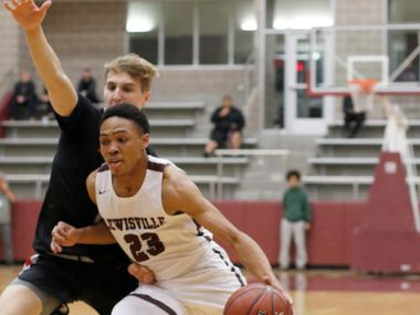 Lewisville's Kylin Green (23) drives hard to the basket as he is guarded by Coppell's Ben Klement (21) during first quarter action. The two teams played their District 6-6A boys basketball game at Lewisville High School in Lewisville on January 28, 2020.