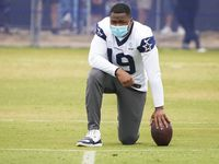 Dallas Cowboys wide receiver Amari Cooper watches from the sideline during a practice at training camp on Tuesday, July 27, 2021, in Oxnard, Calif.