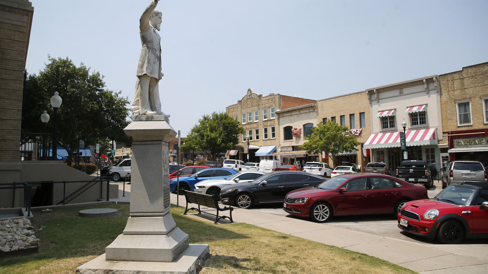 A statue of James W. Throckmorton, a Confederate brigadier general, sits in the McKinney square.