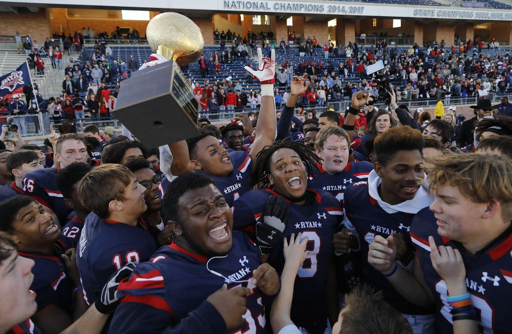 Denton Ryan's Ja'Tavion Sanders (1) holds up the state semifinal trophy after beating Frisco Lone Star on December 14, 2019. (Stewart F. House/Special Contributor)