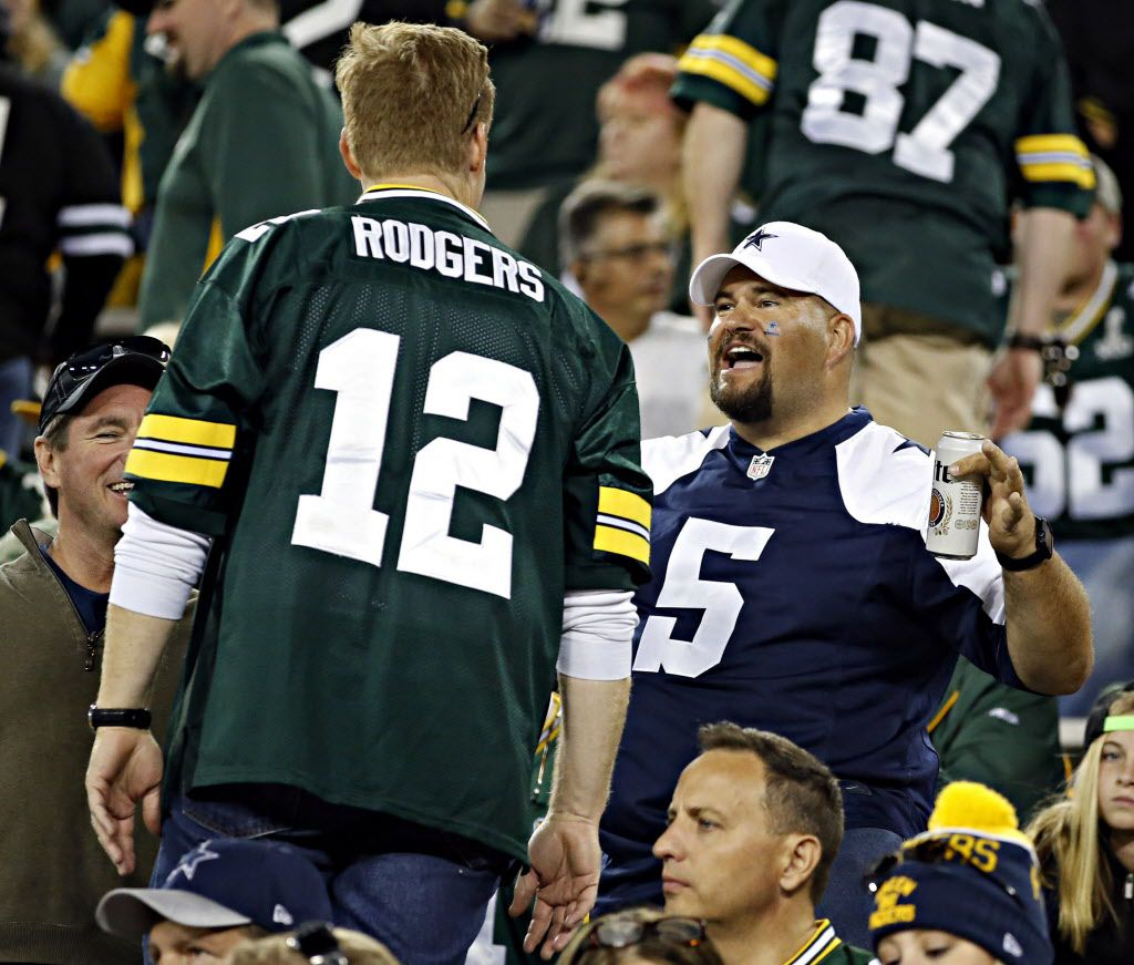A Dallas Cowboys fan heckles a Green Bay Packers fan during the second half of Dallas' 30-16 win Sunday, October 16, 2016 at Lambeau Field in Green Bay, Wis. (G.J. McCarthy/The Dallas Morning News)