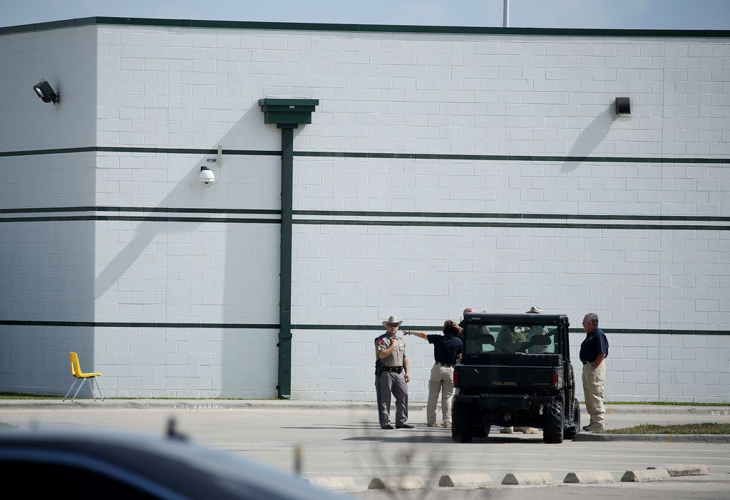 Authorities gather outside of Santa Fe High School in Santa Fe on May 19.