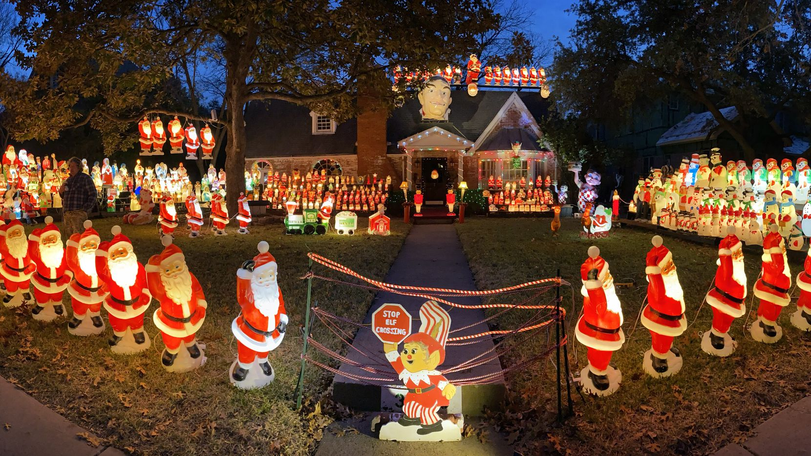 This panoramic view shows the full holiday scene of Wayne Smith's house and yard.