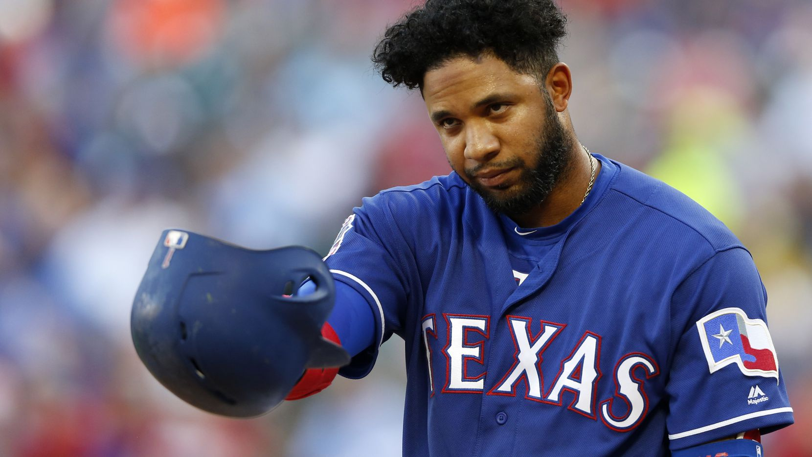 Texas Rangers shortstop Elvis Andrus (1) tips his hat to the Los Angeles Angels dugout before batting during the first inning of play at Globe Life Park in Arlington, Texas on Tuesday, July 2, 2019. Los Angeles Angels Tyler Skaggs was found dead in his Southlake hotel room on Monday prior to the scheduled game against the Texas Rangers.