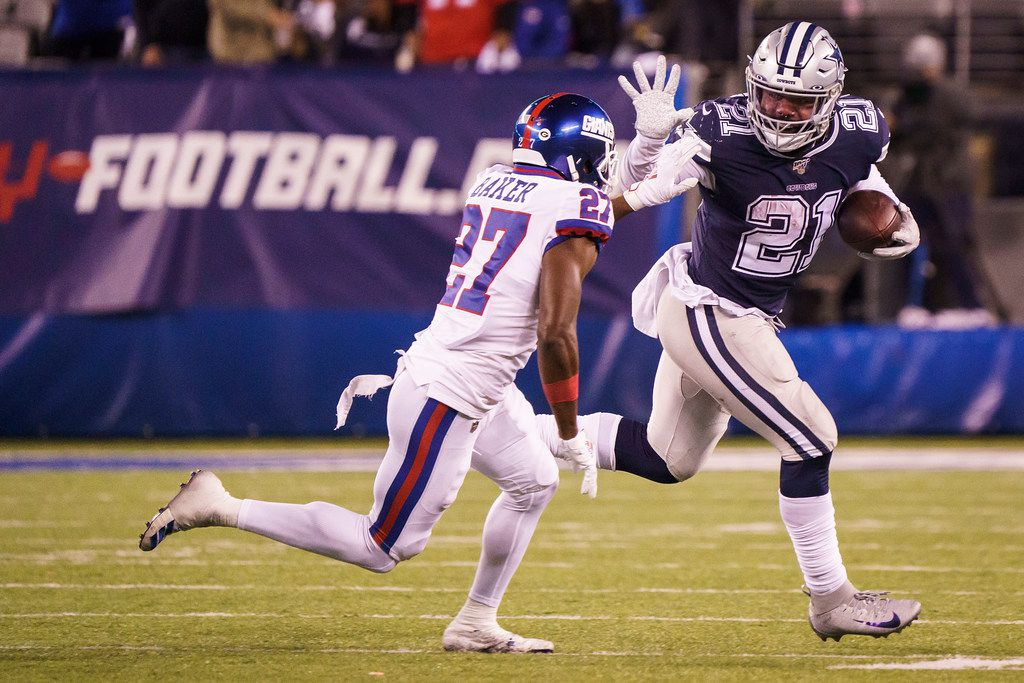 Dallas Cowboys running back Ezekiel Elliott (21) pushes off of New York Giants cornerback Deandre Baker (27) during the second half of an NFL football game, Monday, Nov. 4, 2019, in East Rutherford, N.J. . (Smiley N. Pool/The Dallas Morning News)