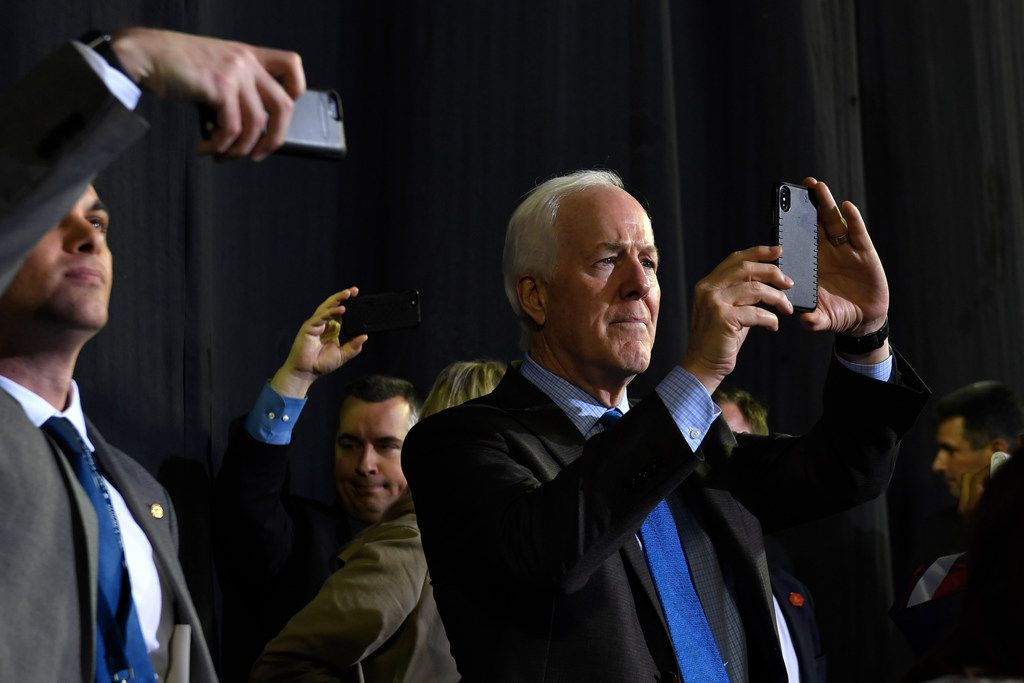Sen. John Cornyn, R-Texas, listens as President Donald Trump speaks during a rally in El Paso, Texas, Monday, Feb. 11, 2019. (AP Photo/Susan Walsh)